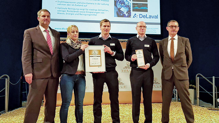 DeLaval Cleaning Analysis crew accepting awards from EuroTier 2016