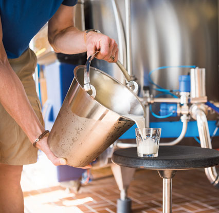 Person pouring milk